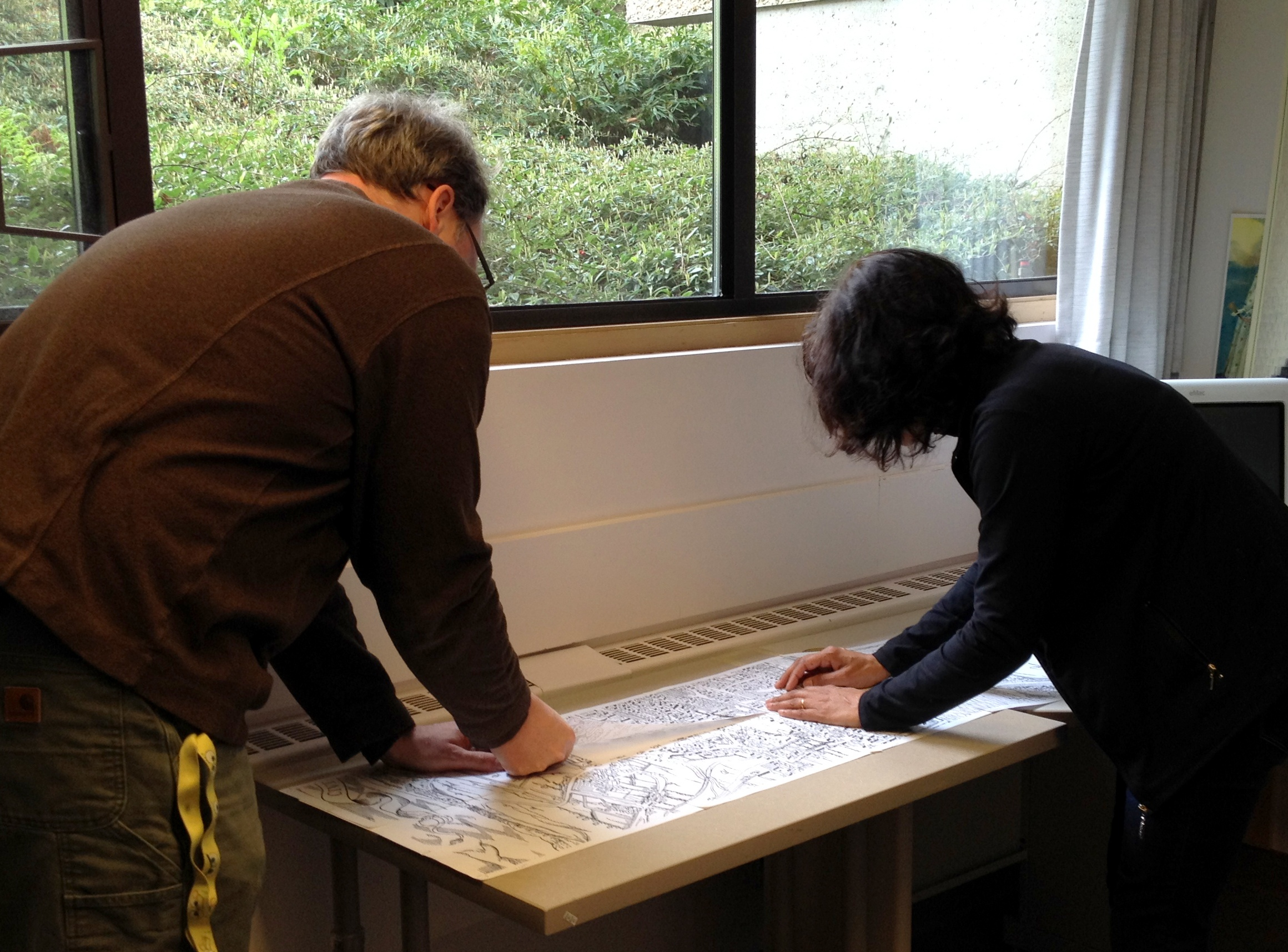 Greg Newton and Jillian Player stitching the